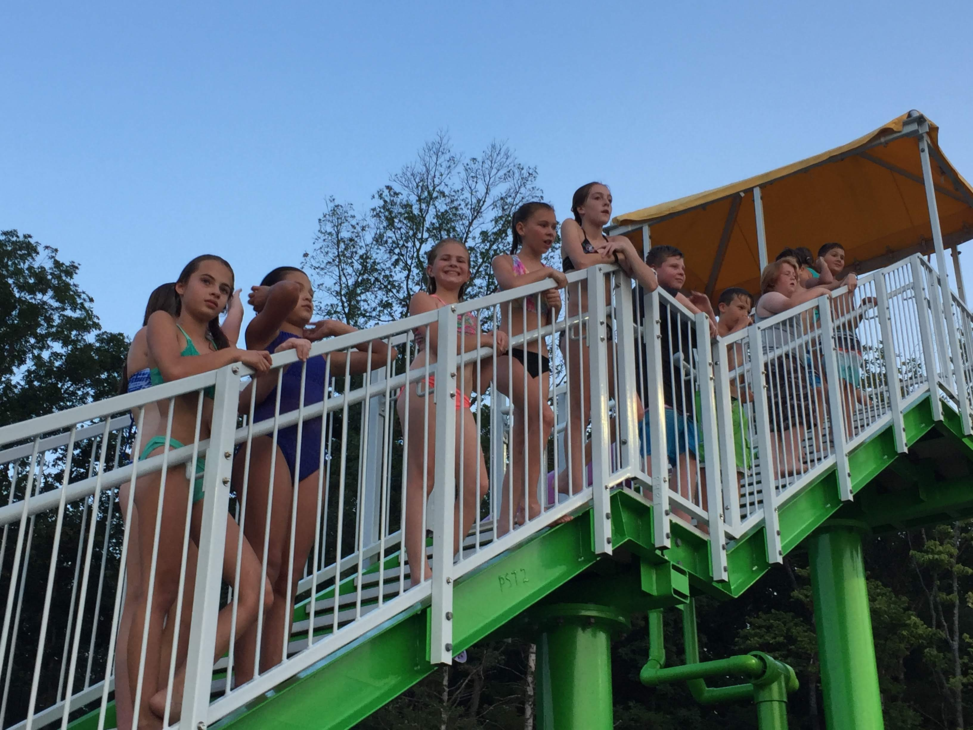 teens waiting in line for a water slide